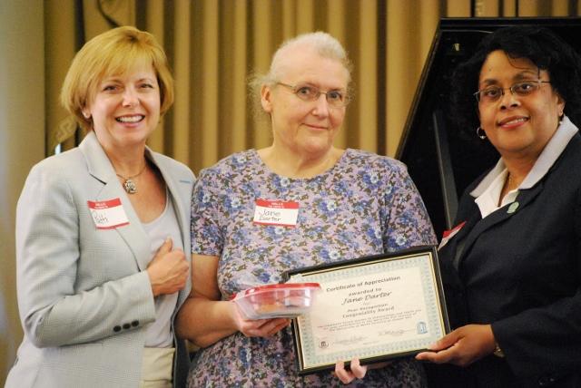 photo of Jane Darter receiving employee forum recognition award for congenialtiy