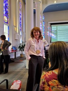 A picture of Erin Fraher, PhD, MPP with a medal for the Data Olympics 2019